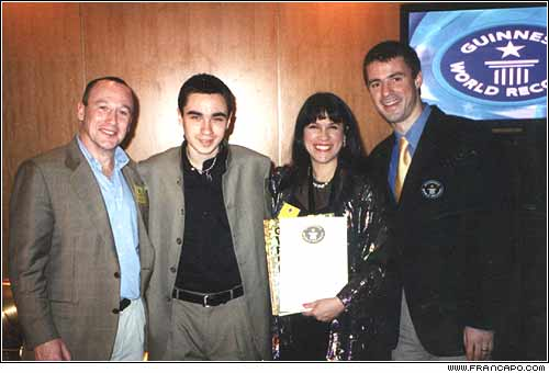 Fran was invited to speak at the celebration of the 50th anniversary of the Guinness Book. She was given a 50th anniversary certificate. She poses here left to right with: Aliston (the CEO of Guinness, her son, Spencer, herself, and Stuart Claxton (researcher and organizer of events).