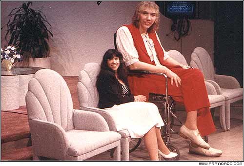 "On the set of the TV show ""AM Buffalo"" with the worlds tallest Woman, Sandy Allen. Yeah, don't we just look like two normal chicks sitting around and talking!"
